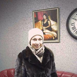 Ольга - татуировка надпись на спине